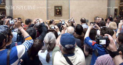 Introspective Magazine (tourists photographing the Mona Lisa)