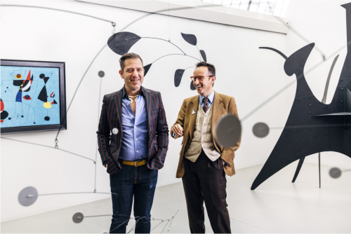 Alexander Rower, left, a grandson of Alexander Calder, and Joan Punyet Miró, a grandson of Joan Miró, at the Calder Foundation with works by the modern masters.