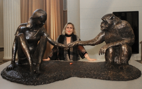 The artist Marla Friedman with her sculpture The Red Palm Nut. In collaboration with and inscribed by Dr. Jane Goodall, The Red Palm Nut is now on permanent display at the Field Museum of Chicago.