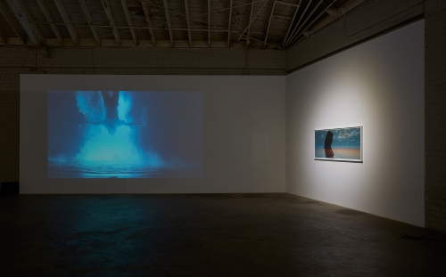 """Illusion,"" installation view, 2016. Pictured: Cheng Ran, ""Angels of the Millennium #6,"" 2012 (video); ""Always I Trust, Film Still No. 2,"" 2014."