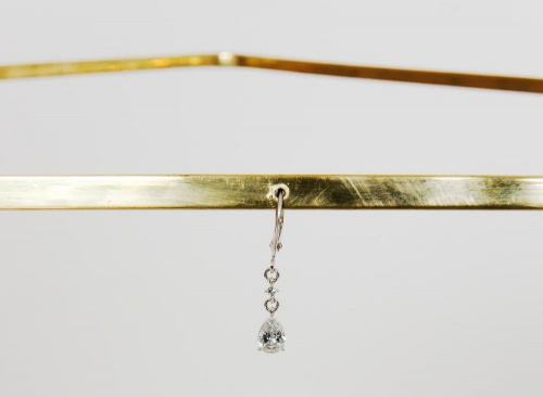 Tania Pérez Córdova: We focus on a woman facing sideways, 2013–16, bronze, Swarovski crystal drop earring, and a woman wearing the other earring. COURTESY THE ARTIST