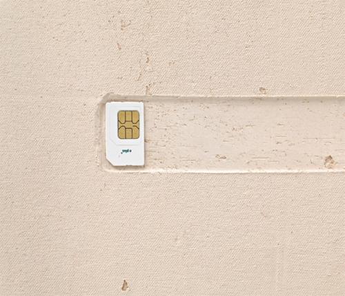 """Tania Pérez Córdova, Person A (detail), 2014, SIM card on ceramic, 17 3/4 × 15 1/8 × 1 1/2""""."""
