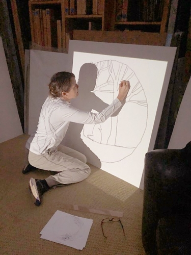 Nicole Strasburg working on the design for her installation at the Wildling Museum, photo from the Santa Barbara News Press