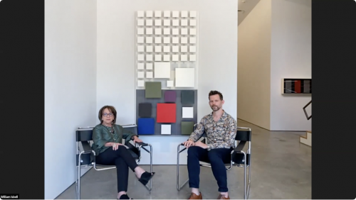 Maria Ines Sicardi [left] and Will Isbell [right] seated in front of Jesús Rafael Soto's Color Inferior, 1991, wood and metal, 79 7/8 x 40 1/8 in.
