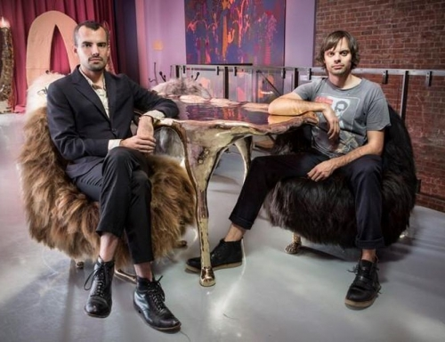 the Haas Brothers sitting on their own furniture designs for a photoshoot for Forbes magazine