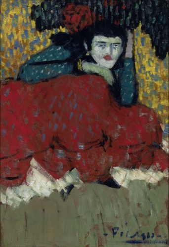 Thi is a cropped image of a painting by Picasso produced in 1901 titled Spanish Dancer. This work is part of the blue period and the dancer's face clothes and background is depicted in light blue tons. The dancer is seating and her legs are covered by a large red skirt.