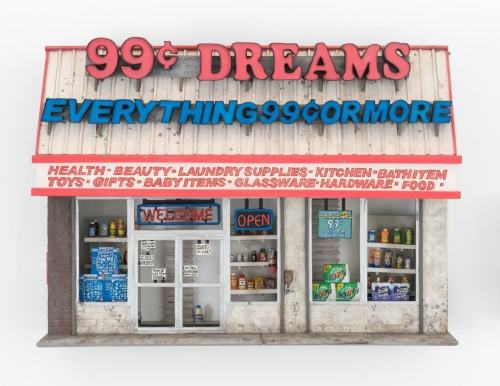 A facade of a 99 cent store made out of foam and paper