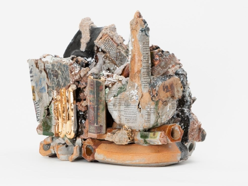 A sculpture of mixed glazes, lusters, and clay