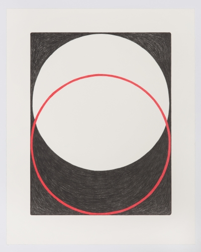 A print of 2 intersecting circles, one outlined in red, with a black background