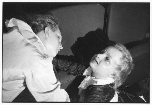 A black and white photograph of 2 female wax dolls in agony