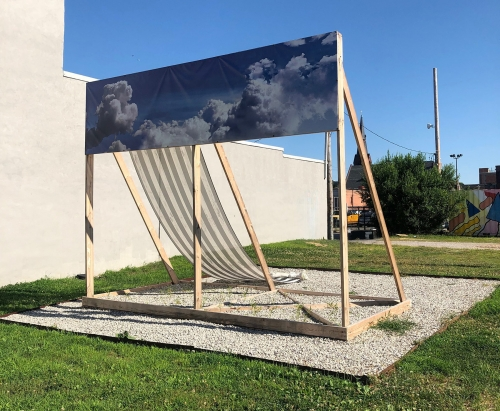 A photograph of Irving's sculpture outside