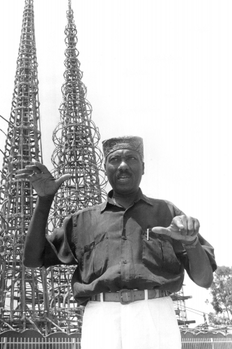 John Outterbridge outside the Watts Towers Art Center in Los Angeles in 1991. He was a leading practitioner of the pieced-together mixed-medium sculpture known as assemblage. Credit: Bart Bartholomew for The New York Times