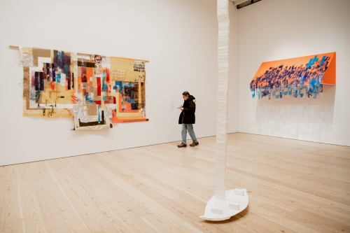 """Tomashi Jackson's """"Hometown Buffet-Two Blues (Limited Value Exercise),"""" left, and """"Third Party Transfer and the Making of Central Park (Seneca Village — Brooklyn 1853-2019),"""" right, are as much about abstraction as racial politics. Olga Balema's Styrofoam """"Leaf"""" is at center. Credit: Vincent Tullo for The New York Times"""