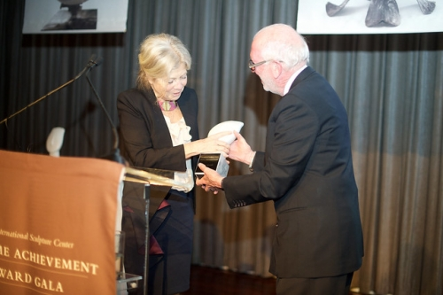 Color photographic of Alice Aycock receiving an award