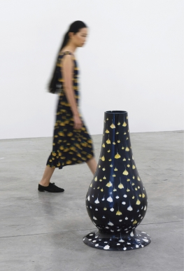 "Tania Pérez Córdova, Portrait of an Unknown Woman Passing By, 2019, glazed ceramic, occasionally a woman wearing a dress, 35 3⁄8 × 19 3⁄4 × 19 3⁄4""."
