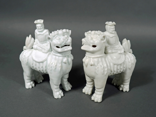 Rare Pair of Blanc de Chine Figures of Foreigners Riding upon Fu Lions