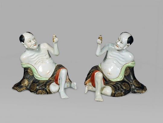 Unusual Pair of Chinese Porcelain Figures of Reclining Lohans