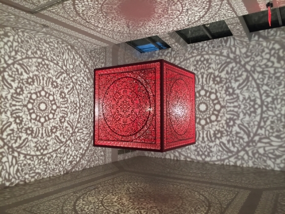 Anila Quayyum Agha  All the Flowers Are for Me (Red - Ed. of 2)  2016   Laser-cut red lacquered stainless steel and bulb  60 x 60 x 60 in.