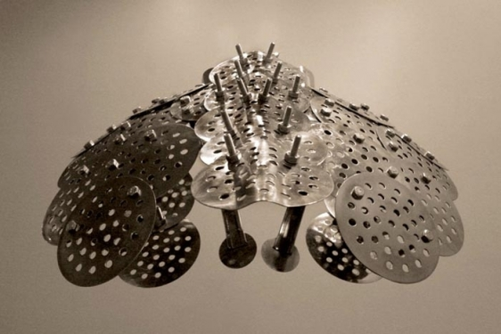 Adeela Suleman CASE 2 2008 Steel drain covers, steel tongs, nuts and bolts, steel measuring spoons, steel frying spoon 18 x 18 x 21 in.