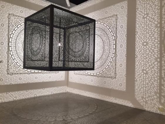 Anila Quayyum Agha SUBLIME LIGHT (Ed. of 5) 2015 Laser-cut black lacquered steel and light bulb 60 x 60 x 60 in.