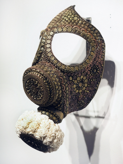 P.D. Pulak Untitled (Gas Mask for the Rich & Famous) Shola flowers, brass  Dimensions variable