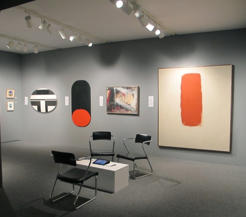 """(from left) Ilya Bolotowsky, """"Black and White Elipse,""""  1963, oil on canvas, 30 x 47 in., Leon Polk Smith, """"Black Over Red,"""" 1960, oil on canvas, 55 x 28 in., Norman Bluhm, """"Winter,"""" 1961, oil and paper mounted on canvas, 28 x 36 in."""