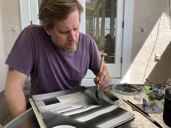 Chris Ballantyne at work in his makeshift studio, March 2020.