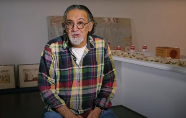 Enrique Chagoya giving an artist talk 2019