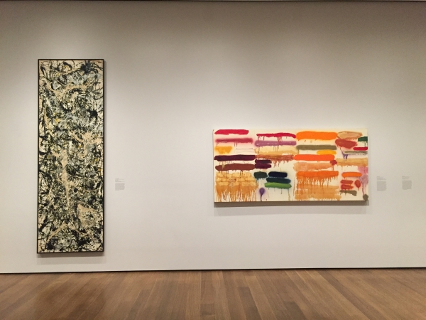 Joan Syder at the Harvard Art Museum next to a Jackson Pollock