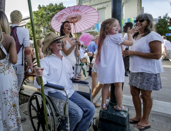 White Linen Night devotees stroll the Warehouse District in search of art, spirits and a good time