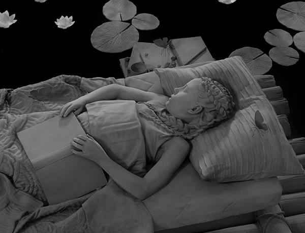 monochrome sculpture of a sleeping girl by Hans Op de Beeck on view at the Kunsthalle Krems