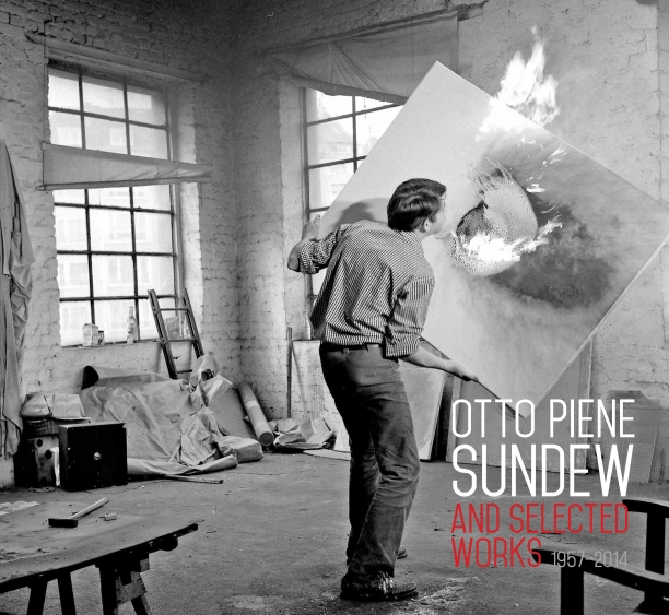 book cover illustrated with a black and white photograph of Otto Piene in his studio holding a canvas that is on fire