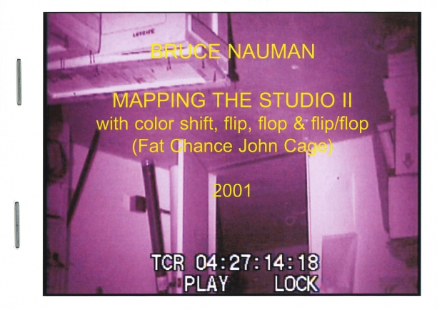 book cover illustrated with a purple film still showing an upside down view of an artist's studio at night