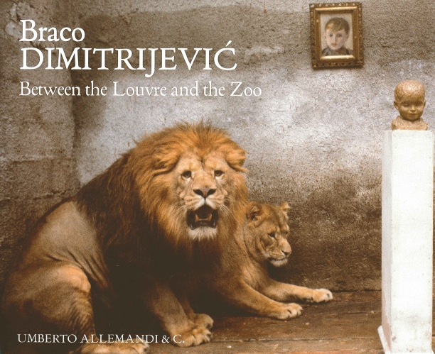 book cover depicting a male and a female lion in a stone room with sculpture of a child's head on a plinth and a portrait of a child hanging on the wall