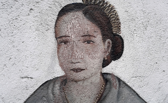 Detail of wall mural, painted portrait of a Filipina