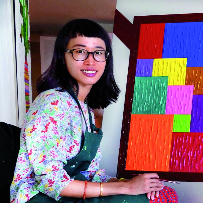 Artist Zhenya Xia with Painting