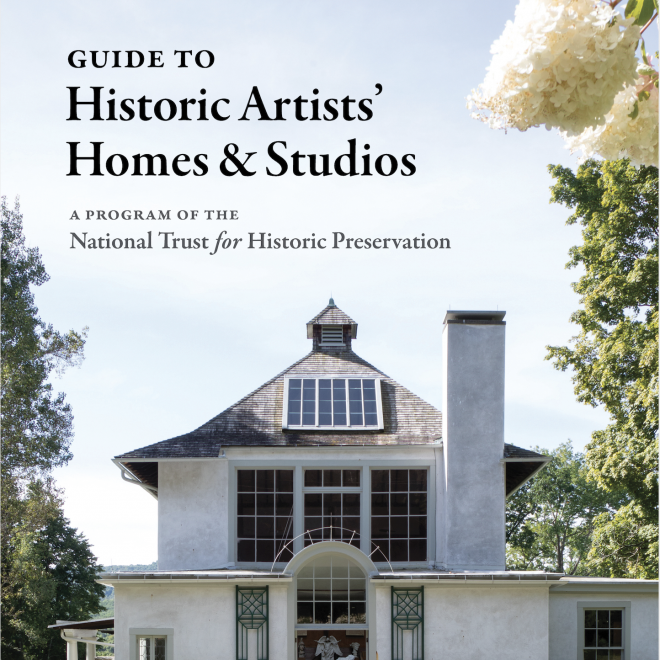 "Photo of a large, white, mediterranean style house with big dark windows on the second floor. Above the house the sky is a pale blue and there is black, ornate lettering, ""Guide To Historic Artists' Homes & Studios A Program of the National Trust for Historic Preservation. On the top right of the frame there is a couple of large, fluffy looking, white flowers."