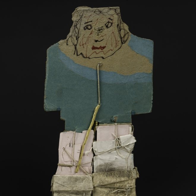a paper construction/sculpture of a man wearing a blue coat by self-taught artist James Castle