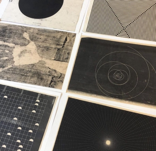 close up of multiple works on paper
