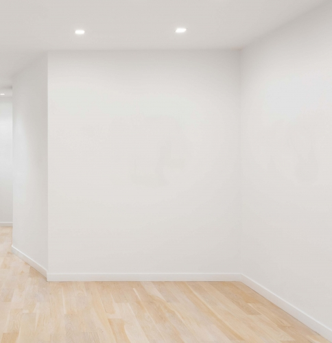 photo of a corner of a room with white walls