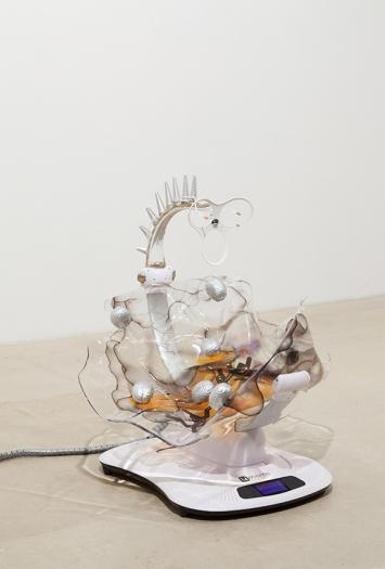 Katja Novitskova Mamaroo (Storm Time, Brains), 2016 Electronic baby swing, polyurethane resin, epoxy foam clay, wall fixtures, foam stress brains 35 x 32 1/2 x 33 inches (88.9 x 82.6 x 83.8 cm)