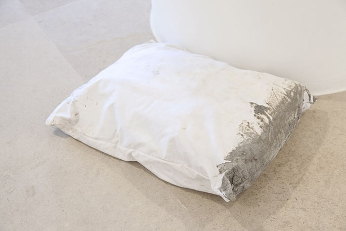 Gerry Bibby, Concrete Nightmares, 2016, Fabric, concrete, concrete bag, 5 x 21 1/2 x 17 3/4 inches (12.7 x 54.6 x 45.1 cm)
