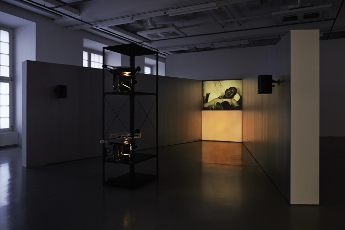 Paul Sharits  Epileptic Seizure Comparison, 1976  Installation with two looping 16 mm film projections, trapezoidal walls, aluminum paint  Dimensions variable