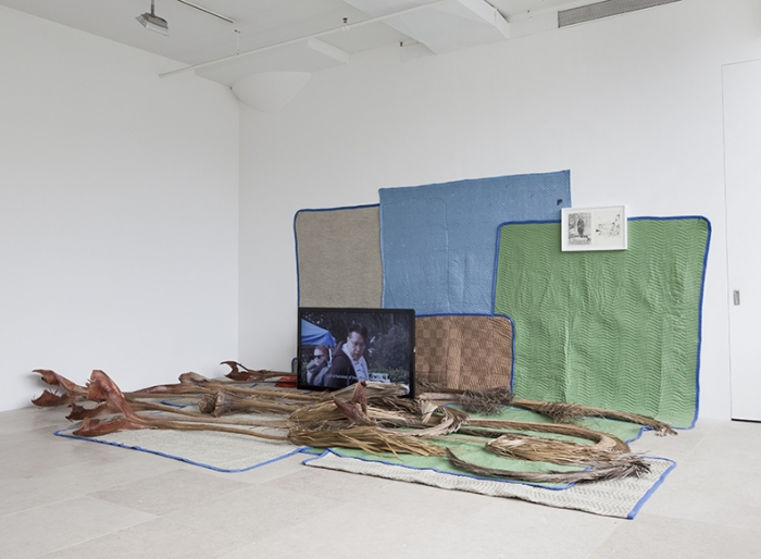 FREAK OUT, Koki Tanaka, Someones junk is someone elses treasure, 2011, Digital video projections w/ sound, palm fronds, moving blankets, money box, framed drawing, dimensions variable