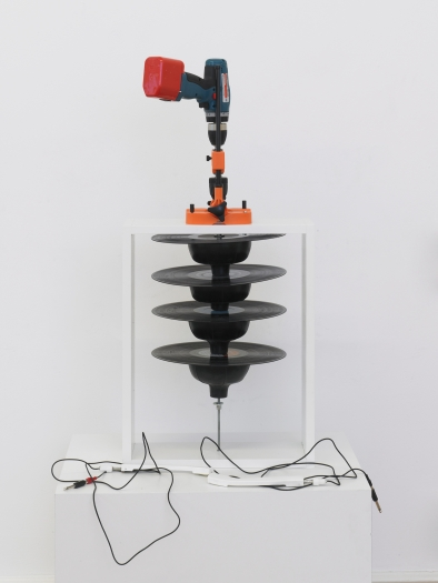 Tony Conrad Pharmonica, 2012 Drill, pipe, drill press, metal mounting flange, 4 12-inch records, plunger heads, band clamps 36 5/8 x 16 1/2 x 15 3/4 inches 93 x 42 x 40 cm