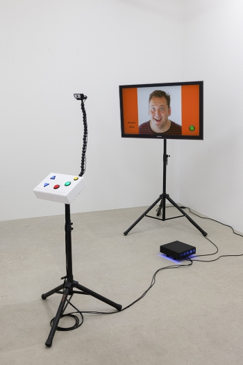 Momoyo Torimitsu Smile :-), Wear it Like a Costume!, 2017 TV (flatscreen), tripods, custom electronics, computer, acrylic Dimensions variable