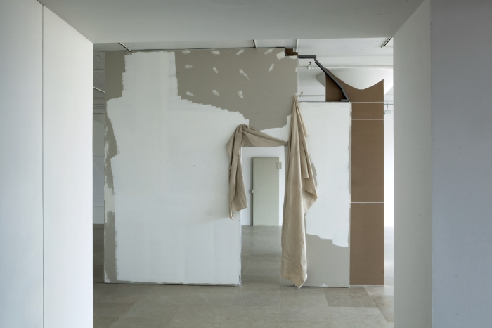 Gedi Sibony The Cutters, 2007 / 2010 Sheetrock wall, paint, hollow core door fragment, vinyl, canvas drop cloth, metallic tape 137 x 164 x 13 inches 348 x 416.6 x 33 cm