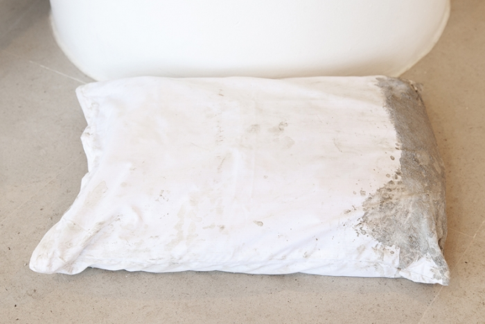 Gerry Bibby, Concrete Dreams, 2016, Fabric, concrete, concrete bag, 5 x 22 x 16 3/4 inches (12.7 x 55.9 x 42.5 cm)
