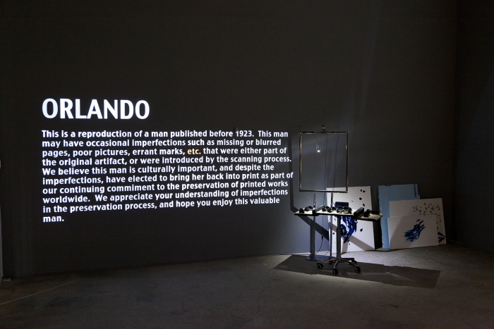 Trisha Baga Ol Rando, 2015 Video installation, glazed ceramic, mural, Styrofoam, plastic cup, clamp light, video projection and sign Dimensions variable