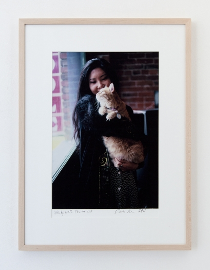 Dan Graham Wendy with Persian Cat, 2001 Color photograph Photo: 13 5/8 x 9 3/8 inches (34.6 x 23.8 cm) Frame: 20 x 15 inches (50.8 x 38.1 cm)